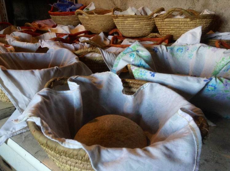 The dough is placed in baskets, wrapped in floured tea towels and left to rise for 4 hours