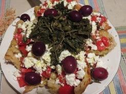 Dhakos - the basic recipe is Cretan dried barley bread, Fresh tomatoes, Feta Cheese and lots of Oilve Oil.