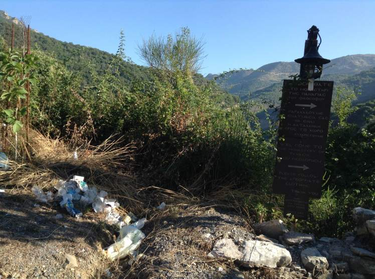 just outside a beautiful old monastery pikes of rubbish line the road