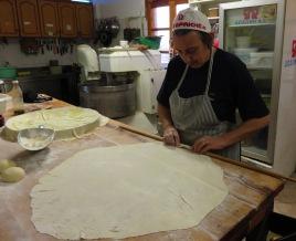 Vasiliki rolling filo pastry to make pita