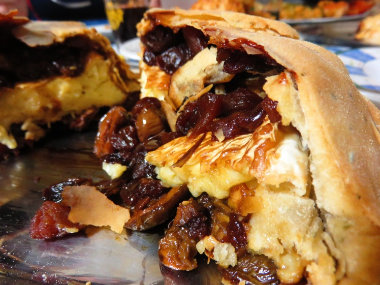 Melting cambert vovered in olive, apple and raisin chutney, inside a crispy rosemary filo case