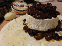Preparing the camembert with olive, apple and raisin chutney.