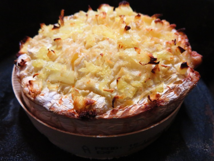 Oozing Ouzo and onion stuffed baked camembert
