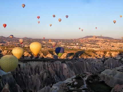 Every morning the balloons rise up for sunrise