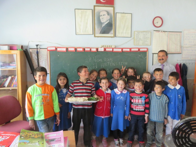 The children and teacher at the tiny school pose with lunch!