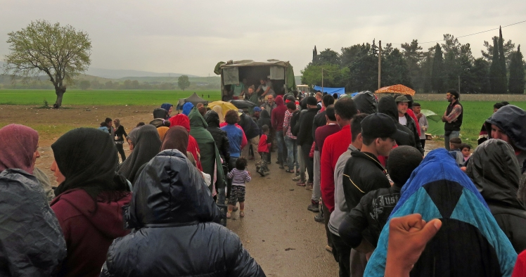 The lines of hungry people queue in the rain